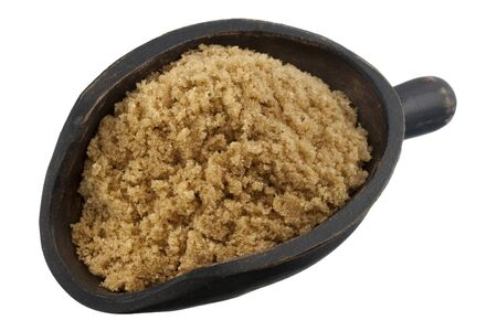 brown cane sugar on a rustic, wooden scoop isolated on white Stock Photo - 4225524