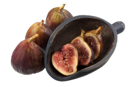 fresh Turkish figs with a rustic, wooden scoop, isolated on white, whole fruits and cross sections Stock Photo - 4225519
