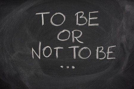 hamlet: to be or not to be, Hamlet question from play by Shakespeare handewritten with white chalk on a blackboard