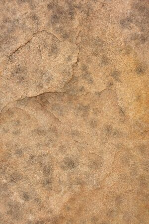 redstone: background of a flat red sandstone with dark spots Stock Photo