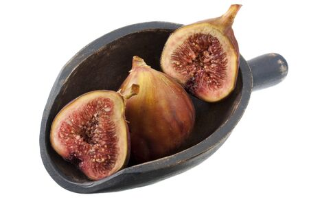fresh Turkish figs on a rustic, wooden scoop, isolated on white, whole fruits and cross sections Stock Photo - 4225521
