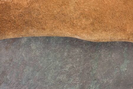 stepping: abstract landscape created with flat stepping stones - red sandstone and purple, green slate rock