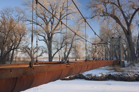 Old abandoned aqueduct (irrigation ditch) suspended across a river in Colorado farmland, winter scenery Stock Photo - 4225548