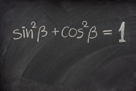 Pythagorean trigonometric identity handwritten with white chalk on a blackboard photo