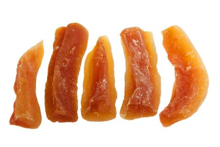 five pieces (spears) of dried papaya fruit isolated on white