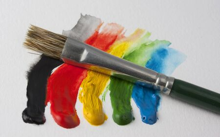 dabs: small paintbrush and 5 dabs (black, red, yellow, green, blue) of watercolor paint on white textured paper