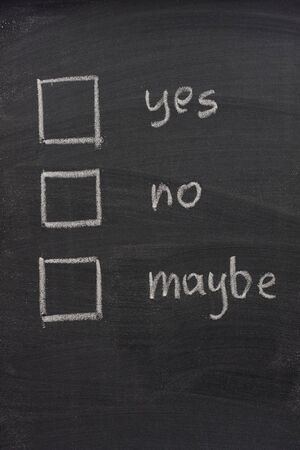 maybe: yes, no and maybe vottng check boxes sketched with white chalk on blackboard