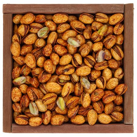 roasted chili lemon pistachio nuts with shells in a rustic, square, wooden box or frame, isolated on white Stock Photo - 4353723