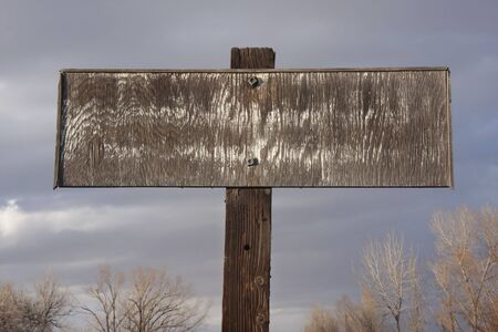 old faded rectangular plywood private propery sign against cloudy sky Stock Photo - 4353722
