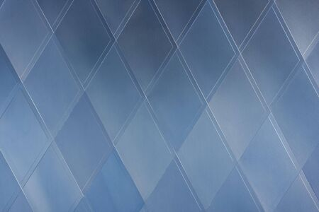 rhomb: architecture abstract - blue building exterior with geometrical rhomb  pattern