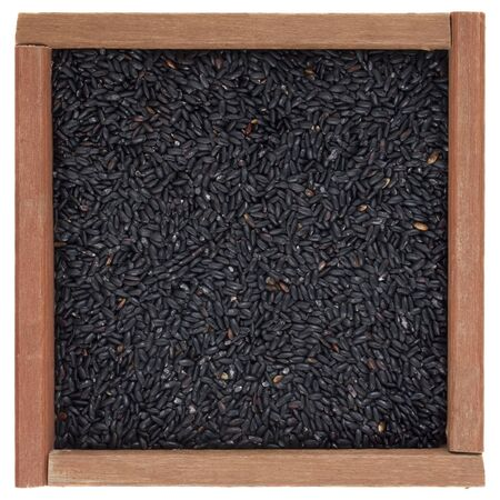 Chinese black forbidden rice in a square wooden box or frame, isolated on white Stock Photo - 4383962