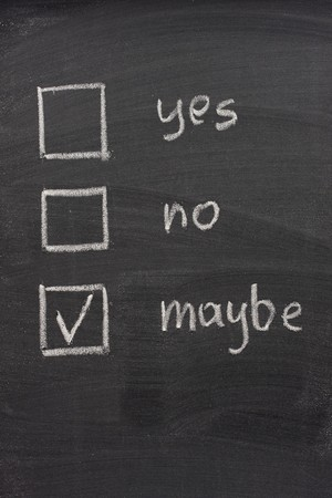 maybe: yes, no and maybe (checked) votting check boxes sketched with white chalk on blackboard, uncertainty or hesitation concept Stock Photo