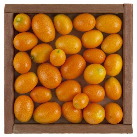 handful of kumquats in a rustic, square, wooden box, isolated on white Stock Photo - 4434653