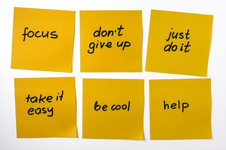 phrases: six yellow sticky notes with reminders and motivational phrases on white background