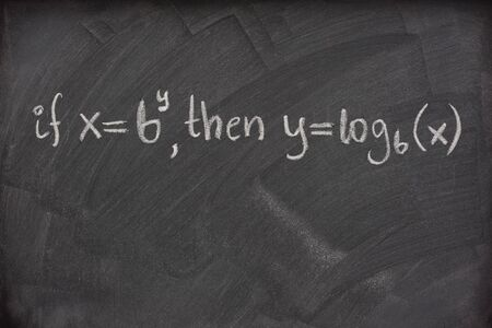 logarithm: logarithm definition handwritten with white chalk on a school blackboard with eraser smudges