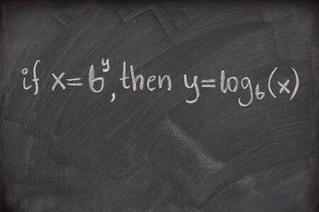 logarithm: logarithm definition handwritten with white chalk on a school blackboard with eraser smudges