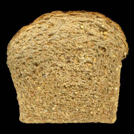 slice of nine grain bread (read and white wheat, barley, buckwheat, corn, flax, millet, oats, rye) isolated on black