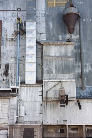 industrial background - a metal exterior of old grain elevator with pipes, ducts, ladders and chutes Stock Photo - 4475084