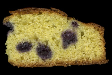 slice of homemade cornbread with blueberries isolated on black Stock Photo - 4491461