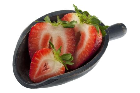 giant sliced strawberry on a rustic, wooden scoop, isolated on white Stock Photo - 4491426