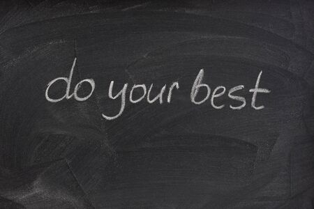 smudge: do your best - motivational phrase handwritten with white chalk on a blackboard with eraser smudge patterns Stock Photo