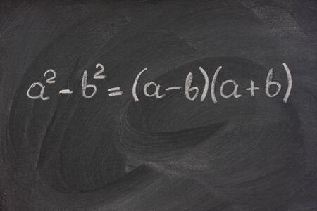 smudge: simple mathematical formula handwritten with white chalk on a blackboard with strong eraser smudge patterns