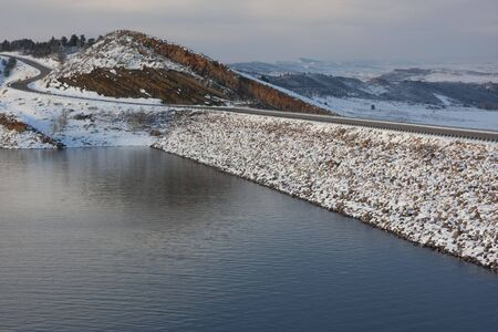 mountain lake, rock cliff, dam and windy road - Horsetooth Reservoir near Fort Collins, Colorado in winter scenery Stock Photo - 4563751