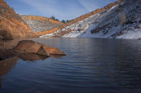 horsetooth rock: mountain lake in Colorado  (Horsetooth Reservoir near Fort Collins) in early spring with red sandstone cliffs and snow Stock Photo