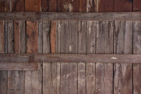 weathered wood of old barn wall with gaps between planks, patches, stains and knots Stock Photo - 4598015