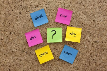 a simple mind map with questions (what, when, where, why, how, who)  to solve a problem posted with colorful sticky notes on cork board Stock Photo - 4612821