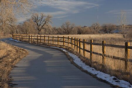 windsor: bike trail in Colorado from Windsor to Greeley along Poudre River in typical winter conditions with just traces of snow