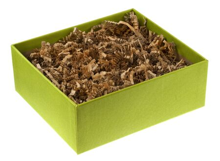 shreded: ecological gift box covered by green fabric, filled with recycled shreded brown paper as packing material.