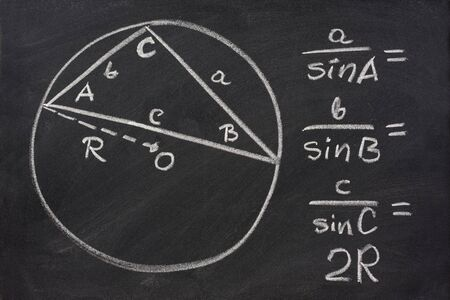 trigonometry indentity - law of sines sketched with white chalk on blackboard, eraser smudges