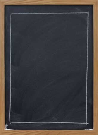 smudge: blank blackboard in wooden frame, large rectangle sketched with white chalk, eraser smudge patterns Stock Photo
