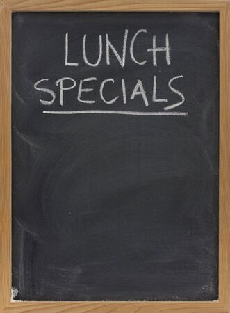 lunch specials title handwritten with white chalk on blackboard, copy space below, restaurant advertisement Stock Photo - 4693418