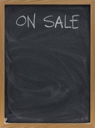 discount sale advertisement handwritten with white chalk on blackboard, copy space below Stock Photo - 4693419