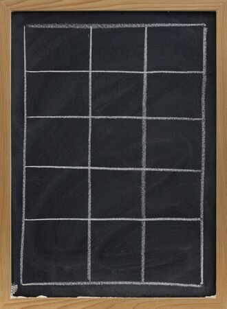 smudges: blank table sketched with white chalk on blackboard with eraser smudges