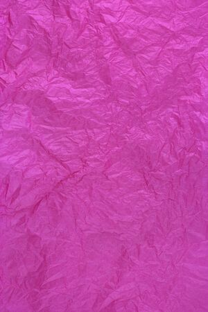 paper texture: dark pink tissue wrapping paper texture, crumpled and wrinkled