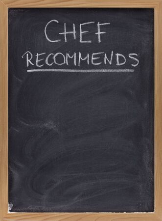 smudges: chef recommends title handwritten with white chalk on blackboard with eraser smudges, copy space below