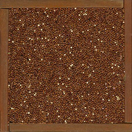 red quinoa: red quinoa grain (originated in the Andean region of South America) in a rustic wooden box of frame
