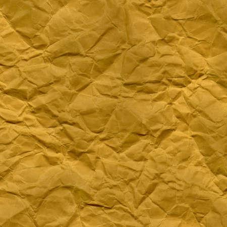 グランジ、しわ、しわや折り目の黄色の紙の背景