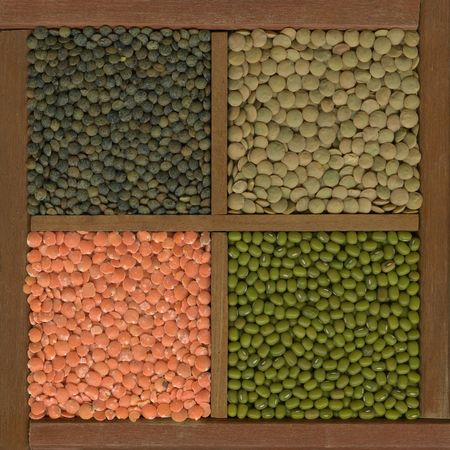 mung bean: mung bean and lentils (red, green, French) in a rustic wooden box with diveiders Stock Photo