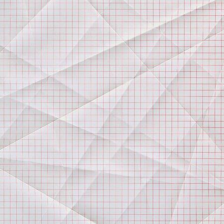 2 つ折り、折り目白い方眼紙の赤いグリッド 写真素材