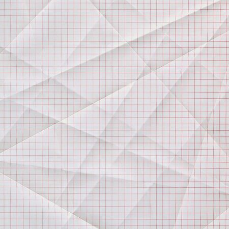 grid paper: folded and creased white graph paper with red grid