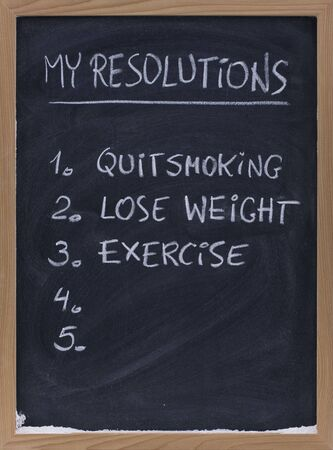 numbered resolution lists (quit smoking, exercise, loose weight, ...) - handwriting with white chalk on small blackbard, copy space Stock Photo - 5041783