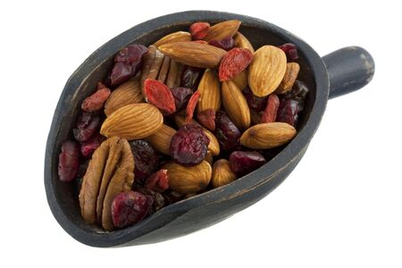 wolfberry: almonds, pecans, dried cranberries, cherries and goji (Tibetan wolfberry) on a rustic wooden scoop, isolated on white