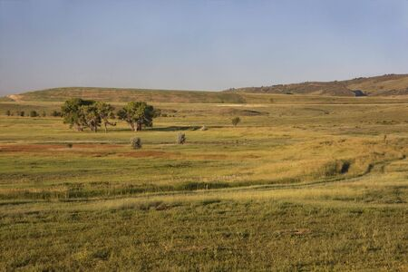 irrigation ditch and a meadow at Colorado foothills near Fort Collins at sunrise Stock Photo - 5139137