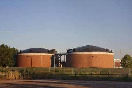 reclamation: two brick round biotower structures at water reclamation facility, Fort Collins, Colorado Stock Photo