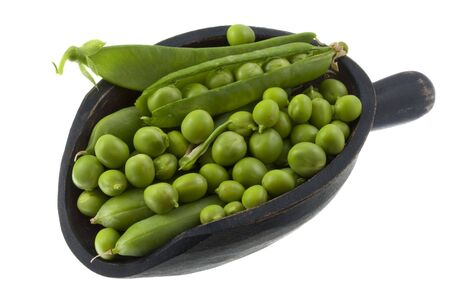 green pea fresh from garden on a rustic wooden scoop isolated on white Stock Photo - 5139118
