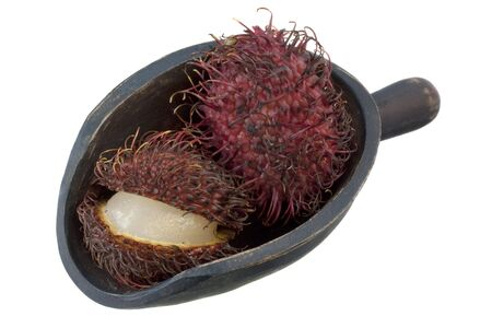 rambutan fruits on a rustic wooden scoop isolated on white Stock Photo - 5139132